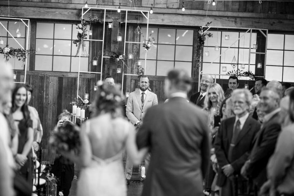documentary wedding photographers in seattle groom watching bride walk down aisle