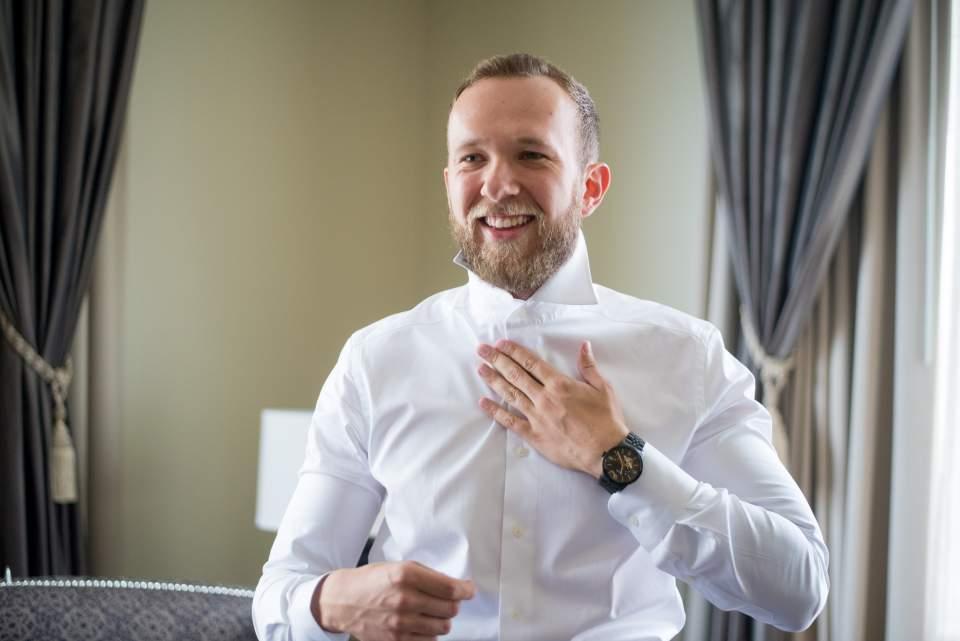 documenting groom getting ready