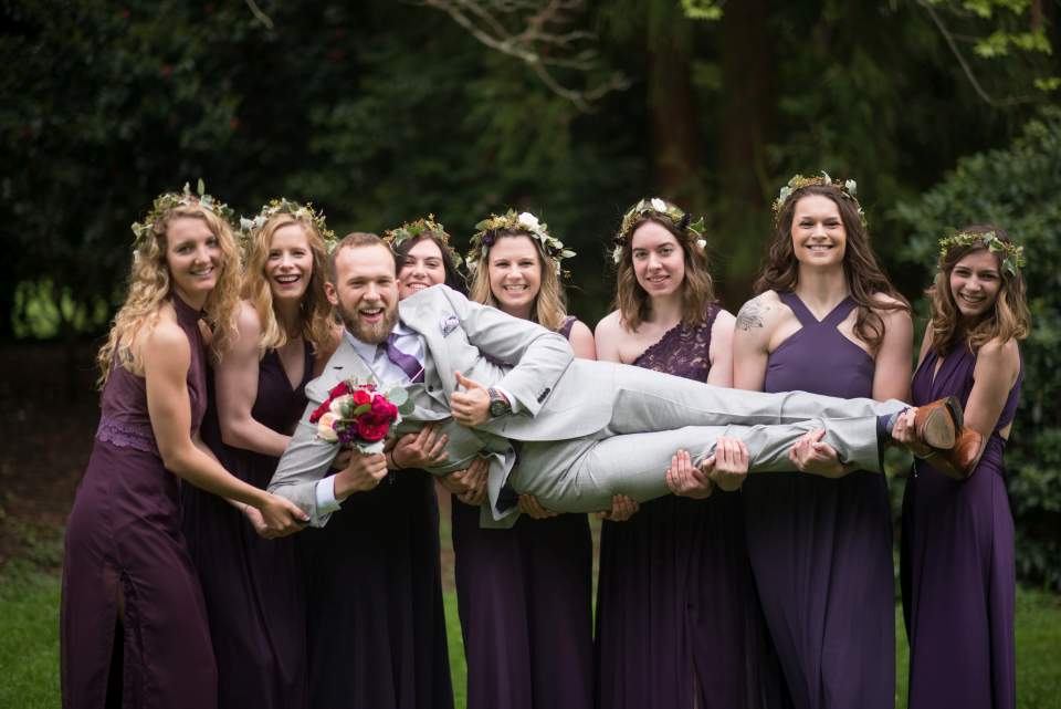 fun bridesmaids holding groom photo