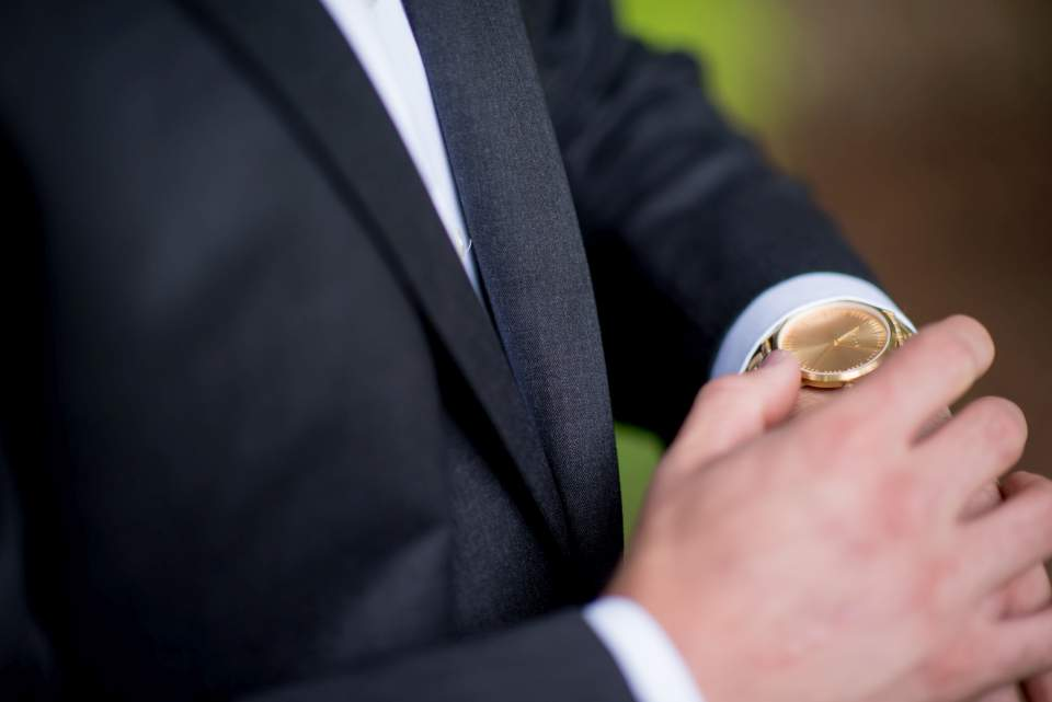groom detail of watch on wedding day