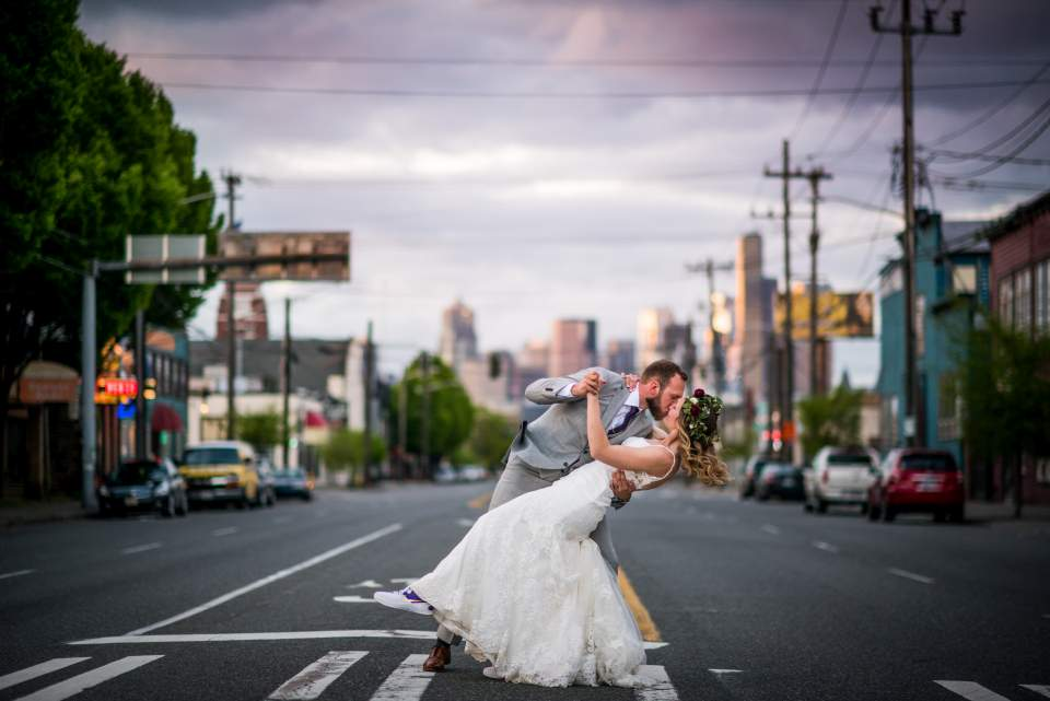 groom dipping bride in middle of seattle street