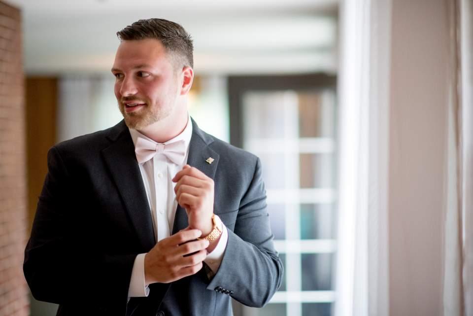 groom dressing for wedding day