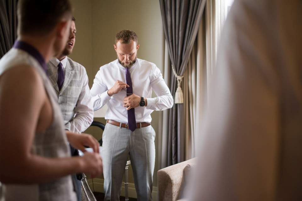 groom prepping for wedding day