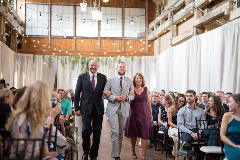 groom walking in with parents