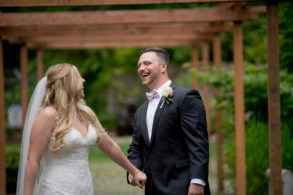 grooms reaction to seeing bride on wedding day