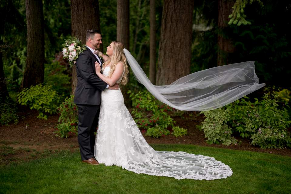portrait of wedding couple with long veil
