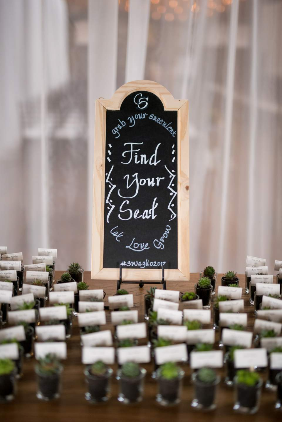 succulent escort cards at sodo park wedding