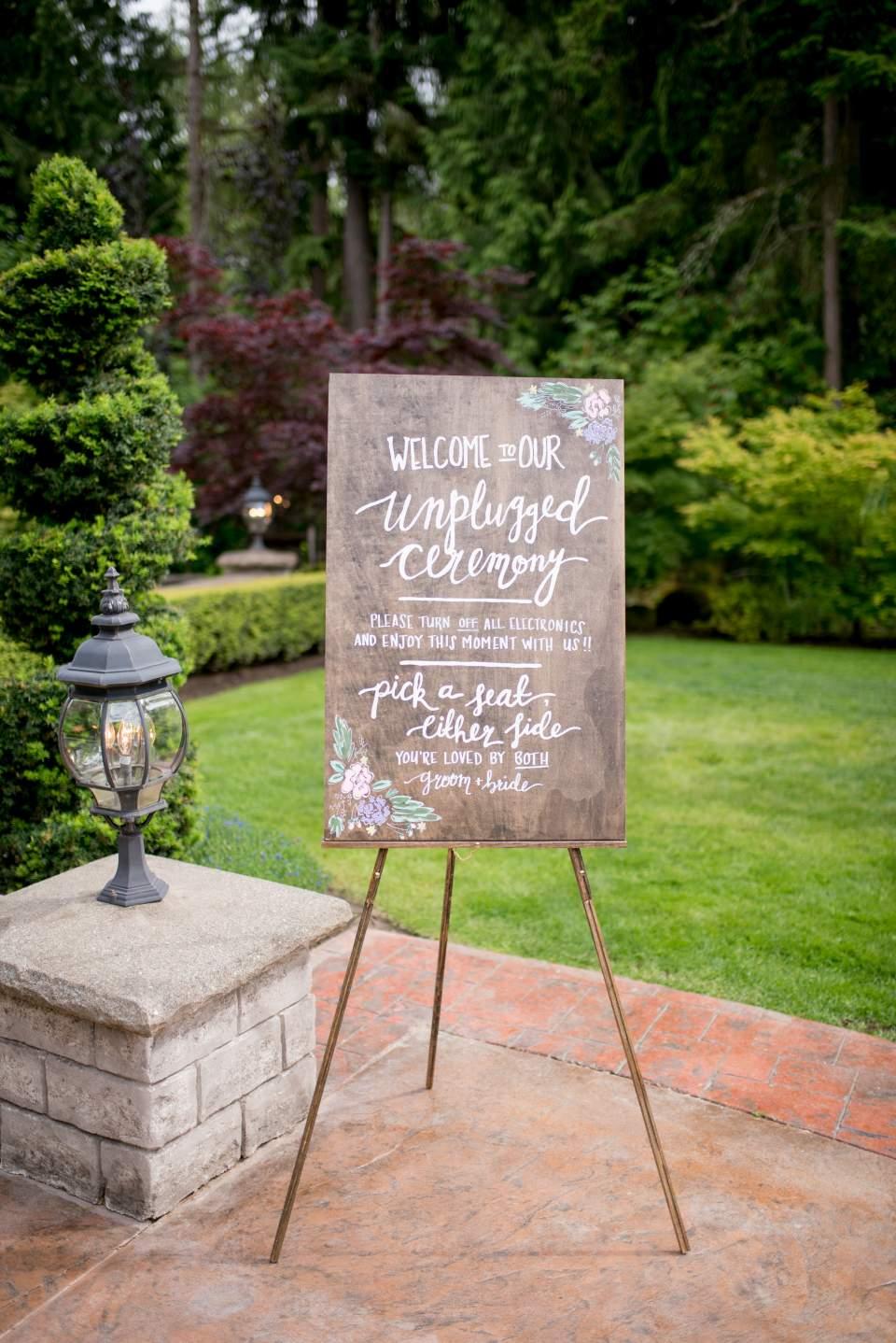 unplugged ceremony sign at rock creek gardens wedding venue