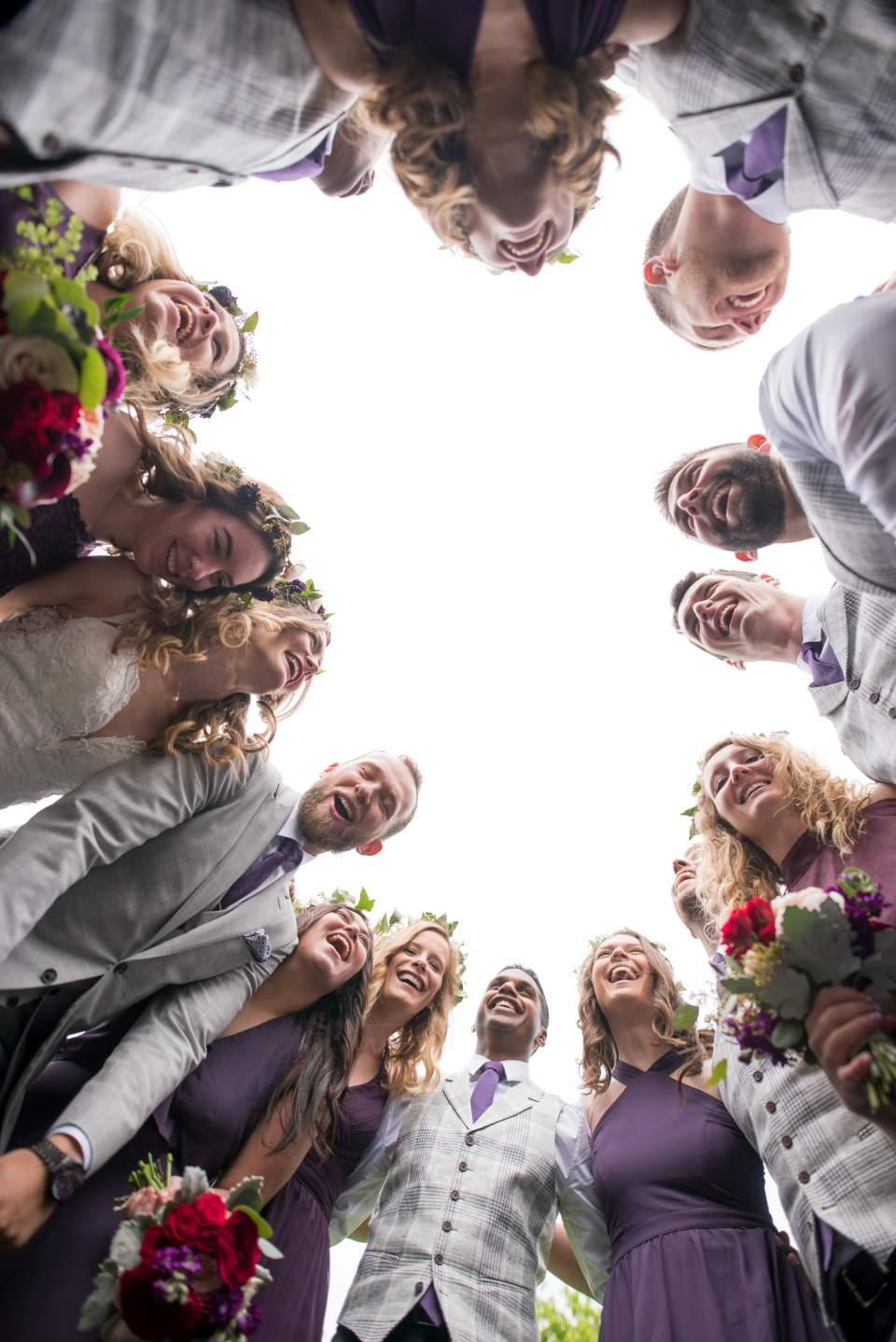 wedding party group huddle creative seattle wedding photos