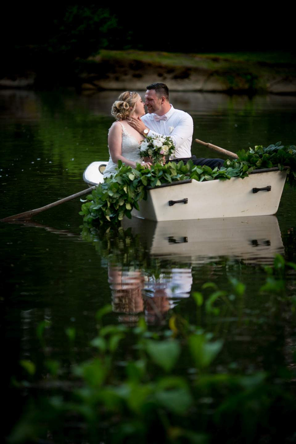 wedding photos in pond at rock creek gardens