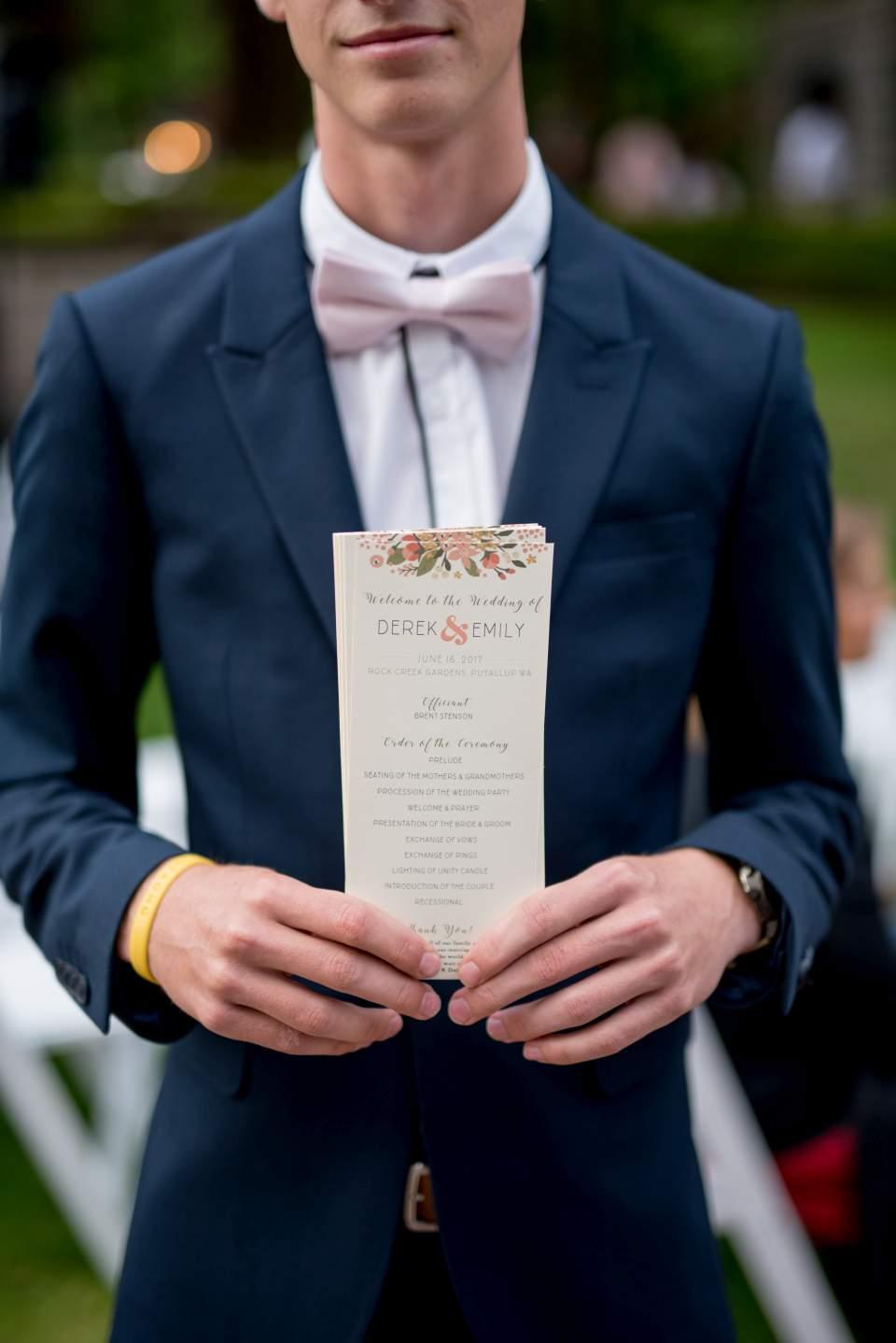 wedding usher handing out programs