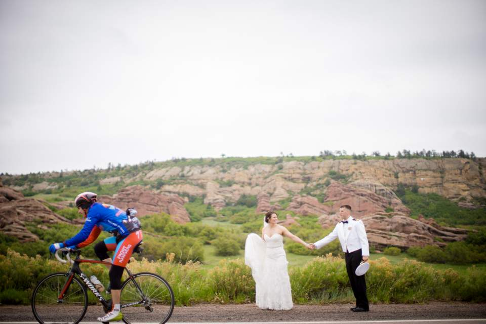 bicyclist photo bomb wedding couple in denver colorado