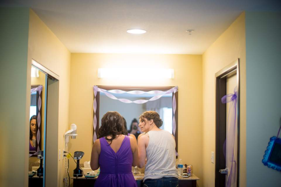 bride and bridesmaid getting ready in hotel