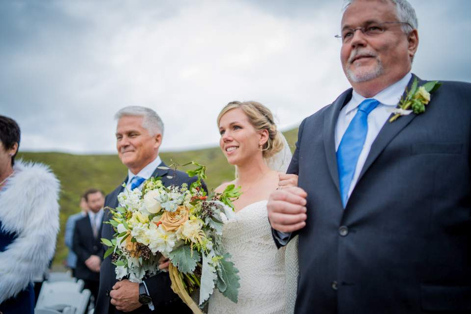 bride and dads walking down aisle