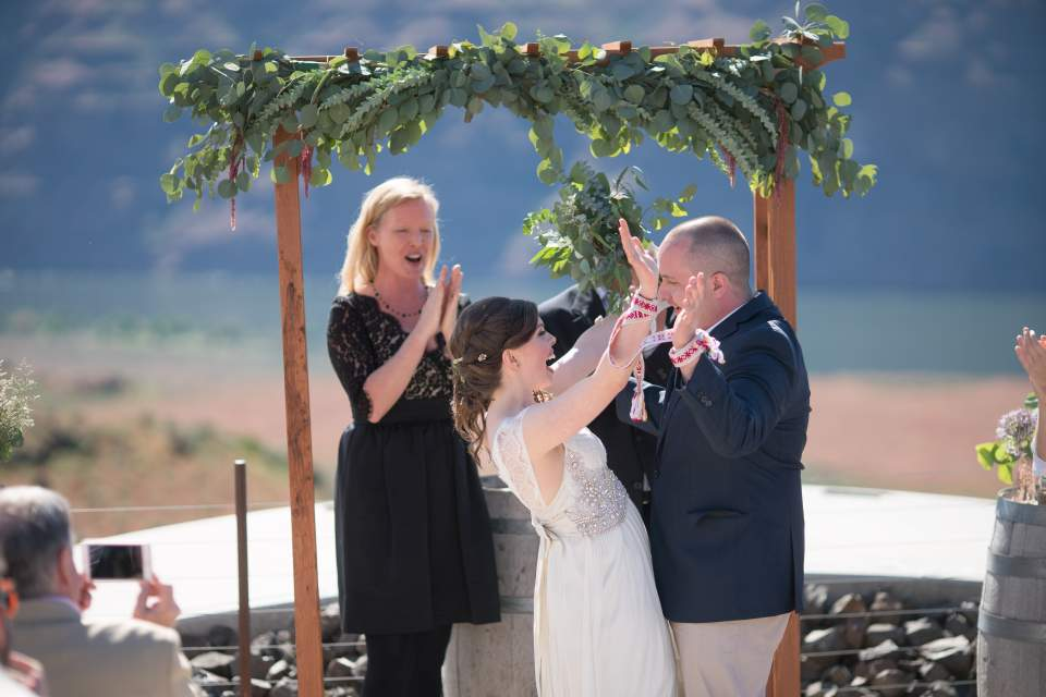 bride and groom celebrate the end of their wedding ceremony