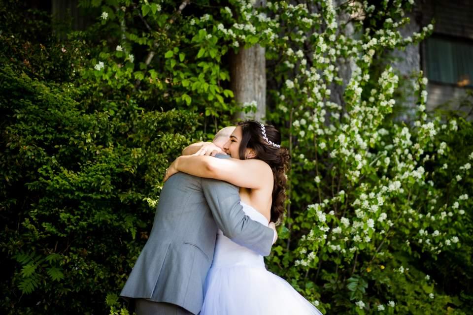 bride and groom first look emotional