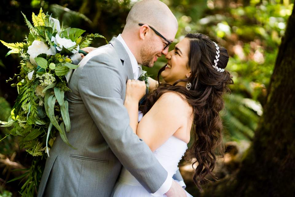 bride and groom holding each other lake quinault lodge