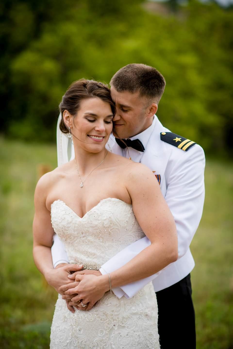bride and groom hugging wedding photos