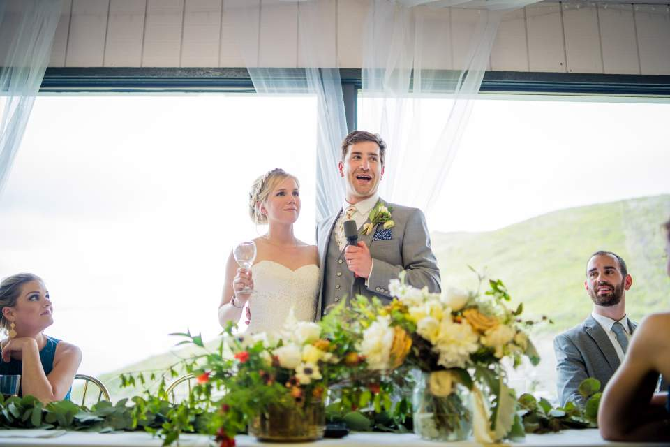 bride and groom toasting friends who traveled to their destination wedding in alaska