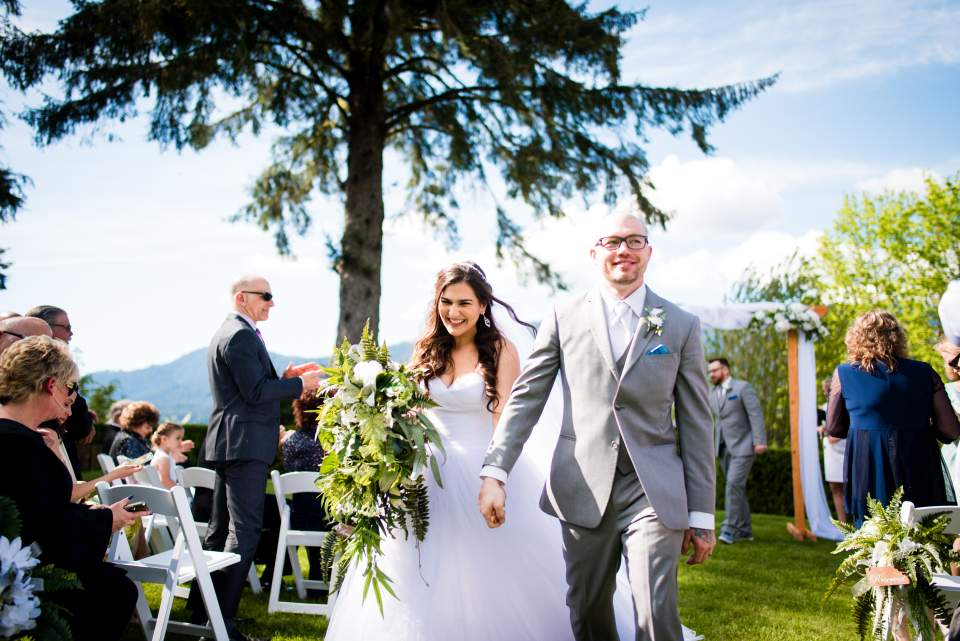 bride and groom walking down isle together