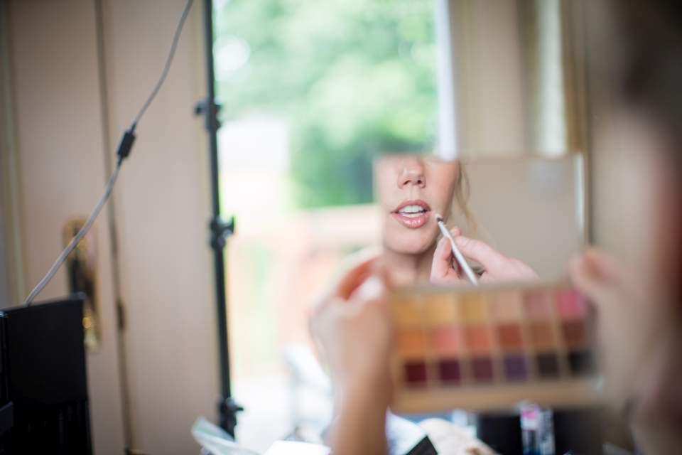 bride looking at make up in mirror