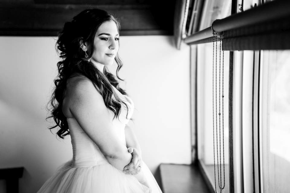 bride looking out window lake quinault lodge