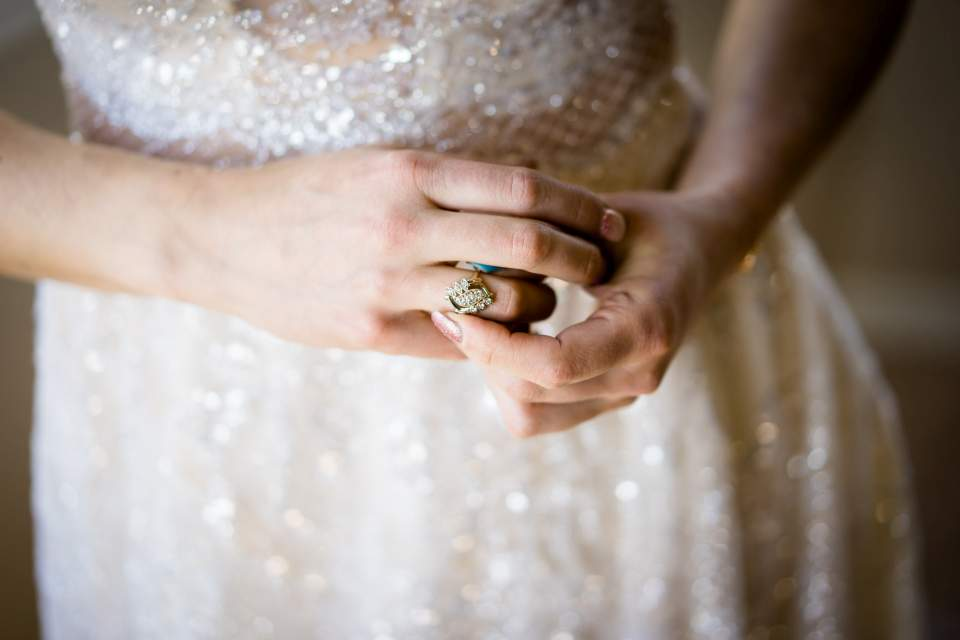 bride playing with ring nervously before wedding