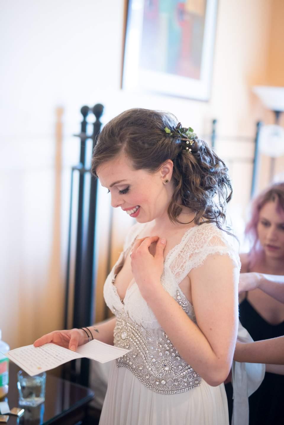 bride putting dress on