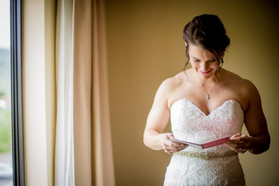 bride reading a note from her groom documentary style wedding photography