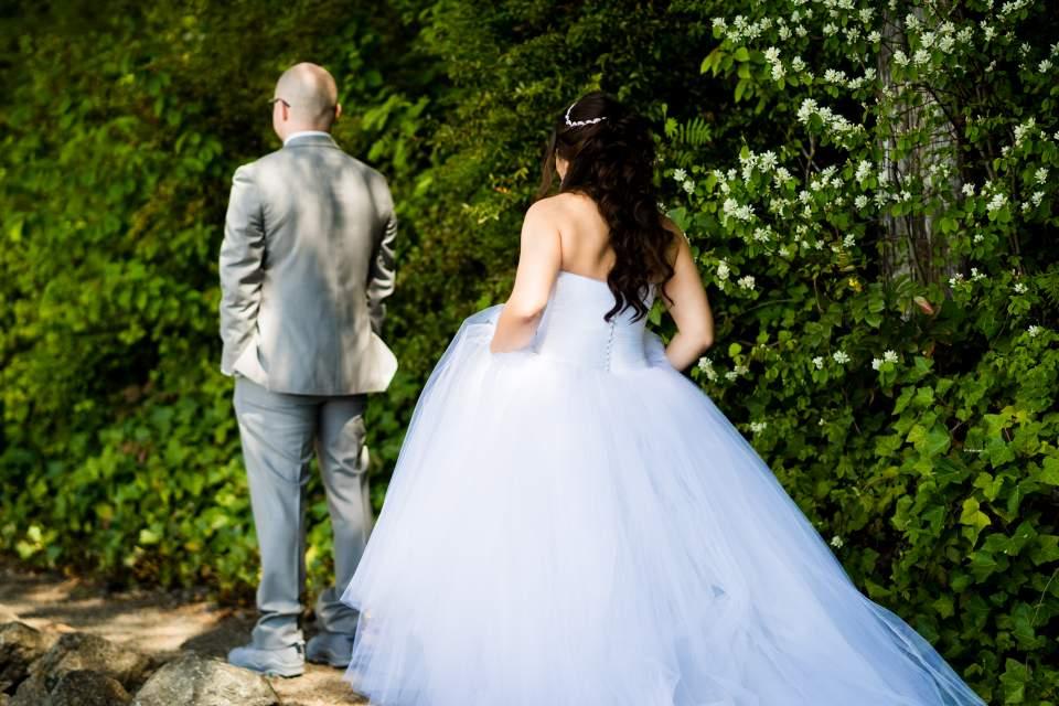 bride walking towards groom first look photos