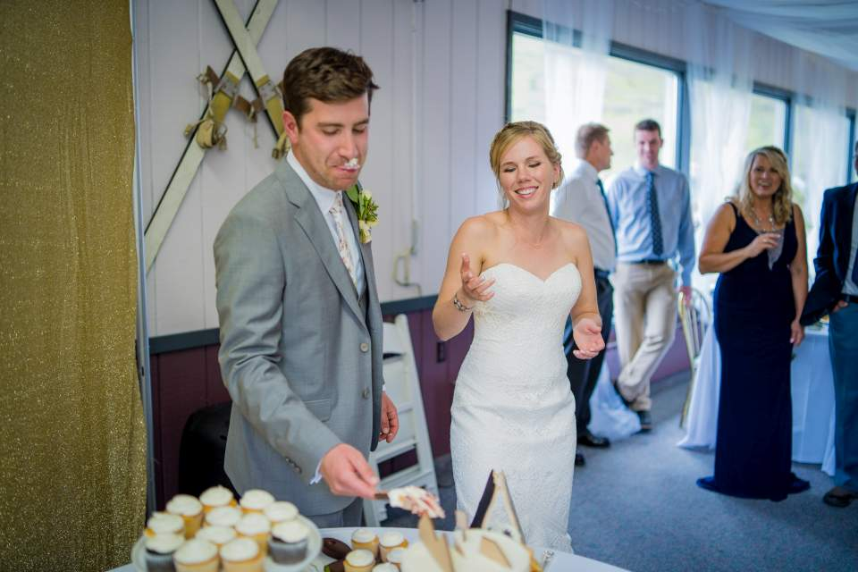 bride wipes cake on grooms face