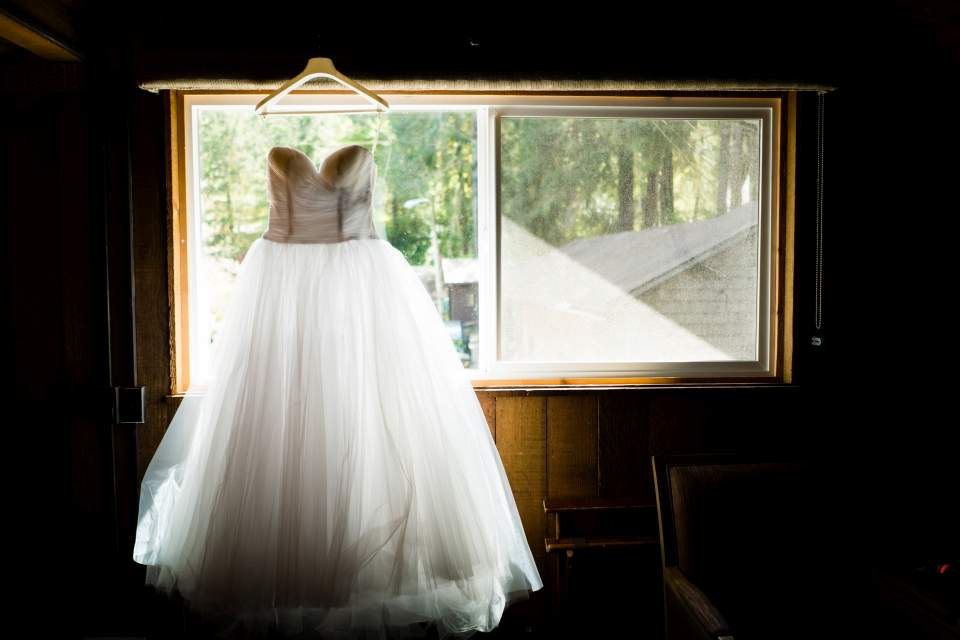 brides dree hanging in cabin window lake quinault lodge