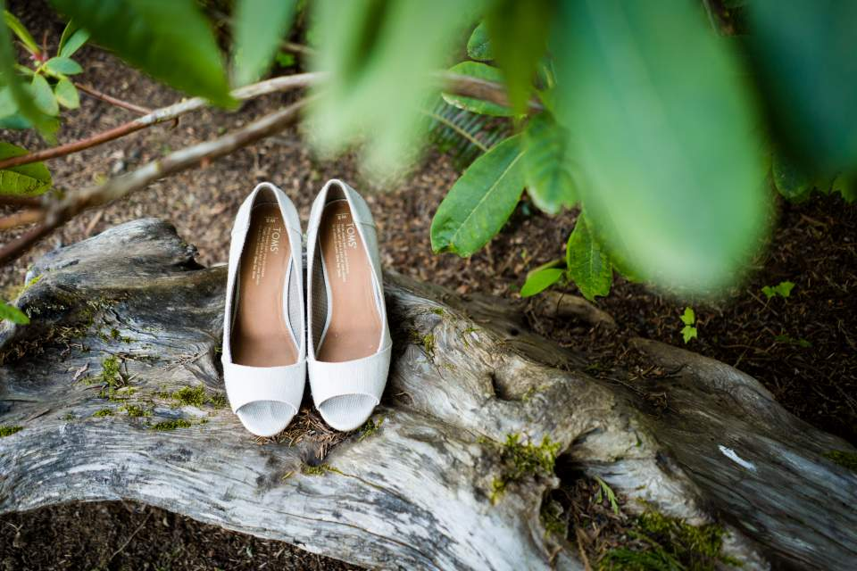 brides shoes in the forest