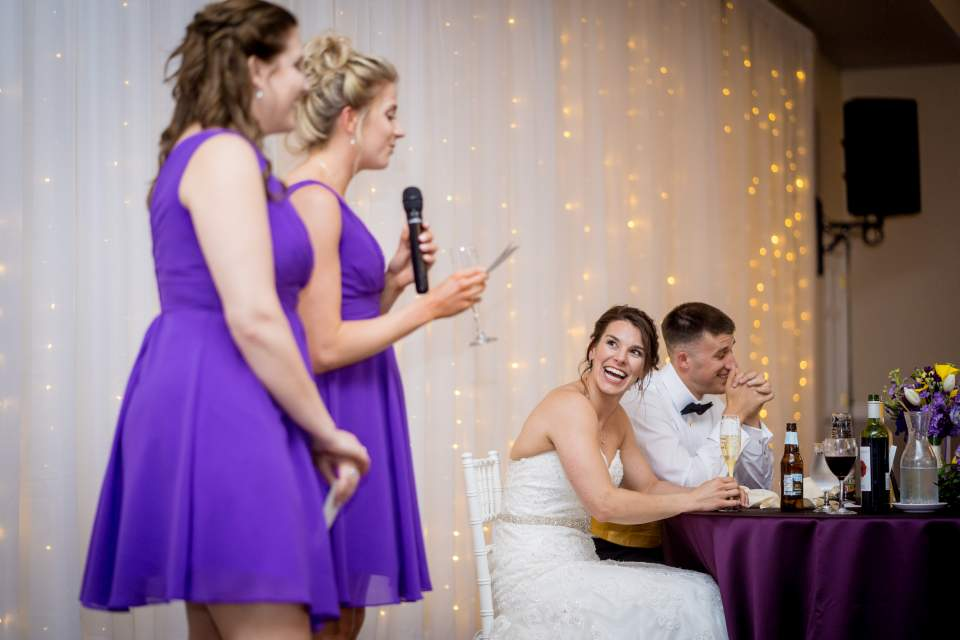 bridesmaids giving wedding toasts