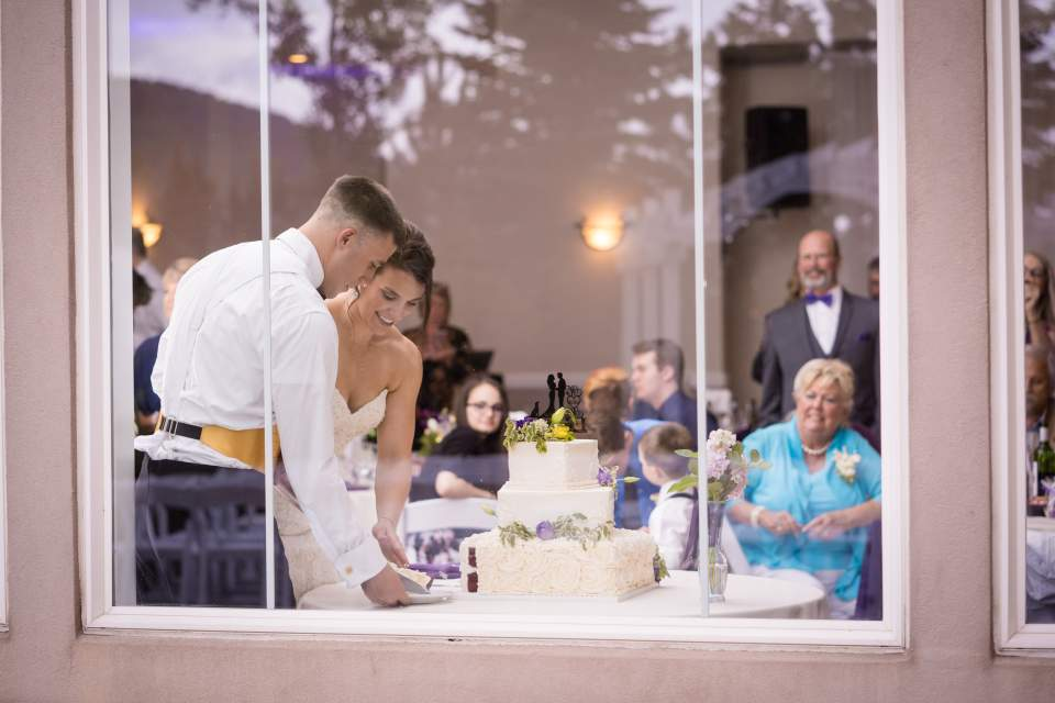 cake cutting ceremony photographed through a window