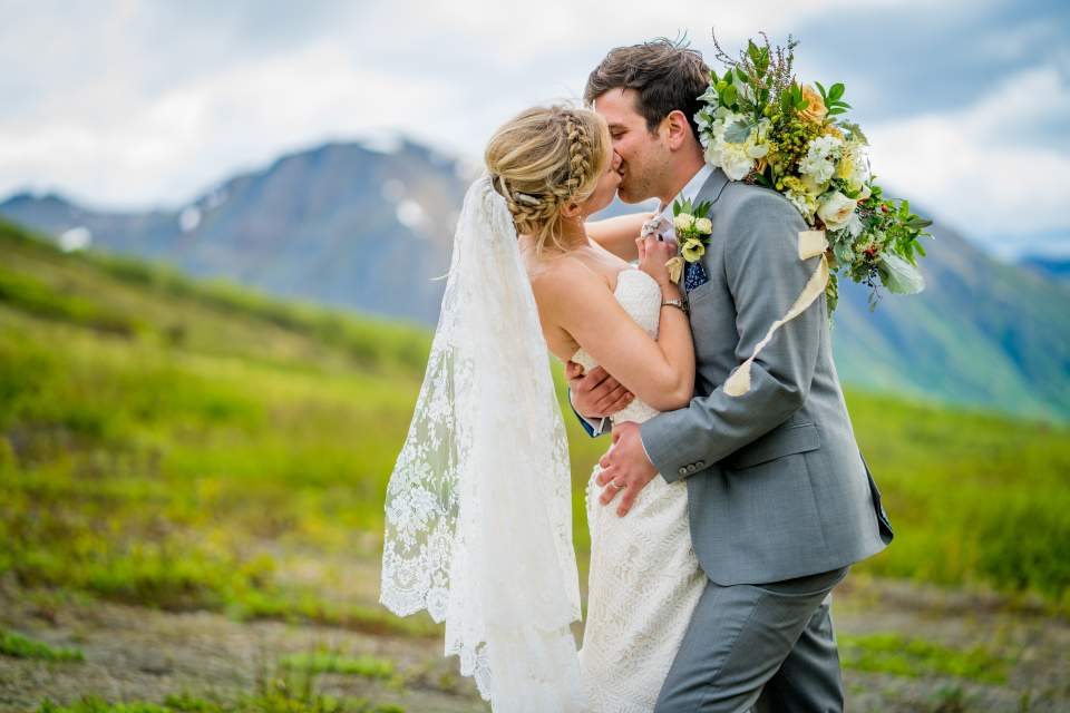 couple kissing romantic wedding photos