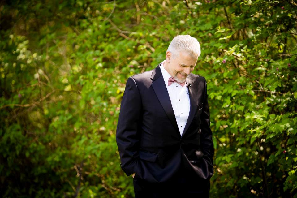 dad waiting to see his daughter on her wedding day
