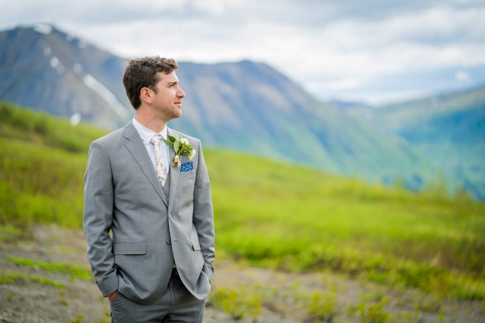 dapper groom portrait in mountains