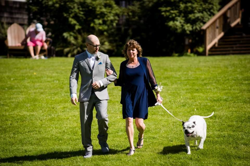 dog and groom walking wedding ceremony