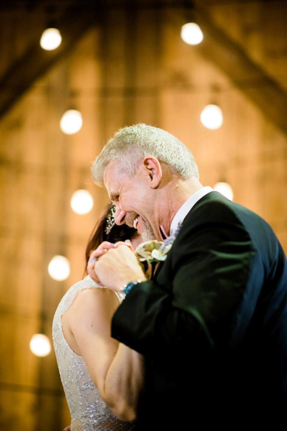 emotional dad during father daughter dance