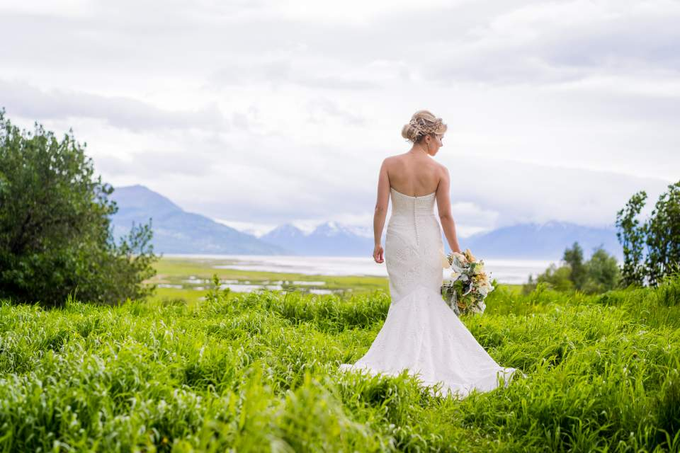 epic portrait of bride with dress blowing in wind