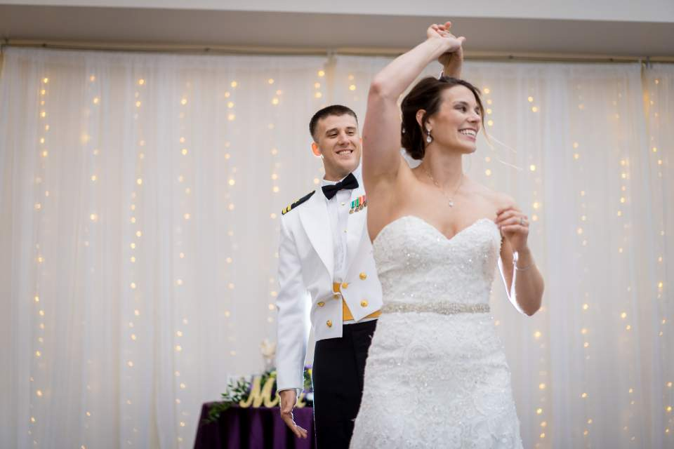 first dance in front of twinkle light backdrop