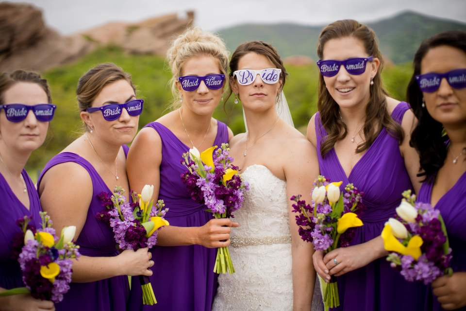 fun photo of bridesmaids wearing wedding party sunglasses