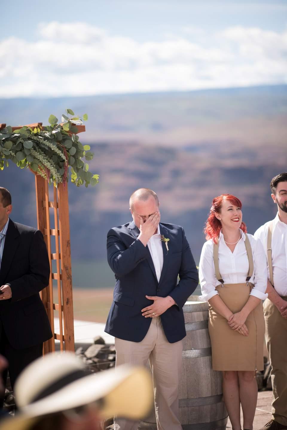 groom crying watching bride walk down aisle