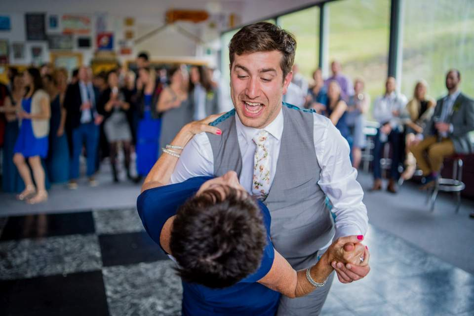 groom dips mom during parent dance