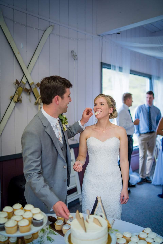 groom feeds bride cake