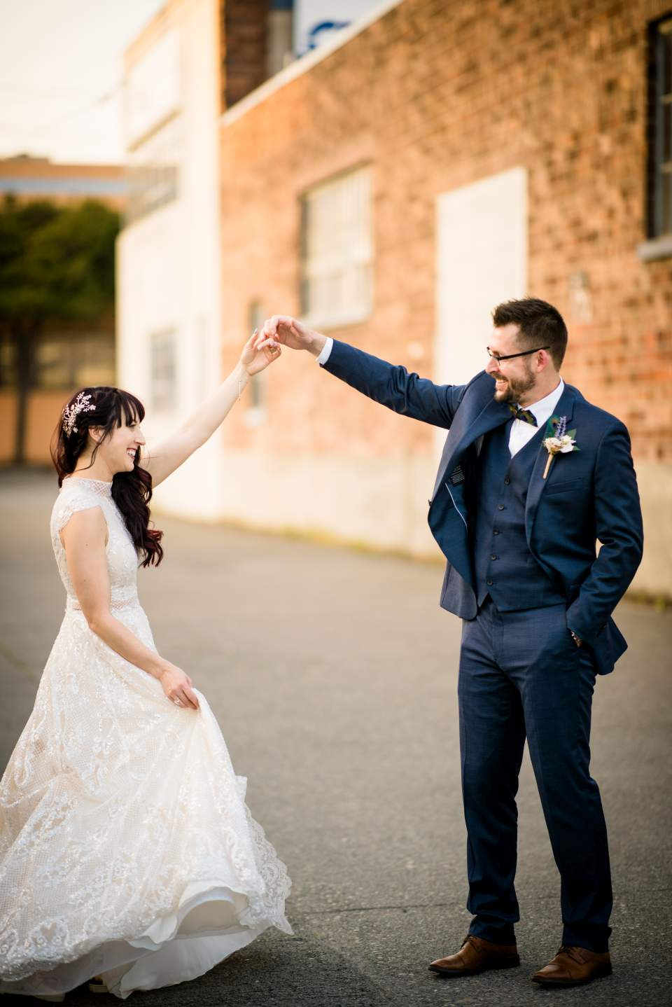 groom giving his bride a twirl