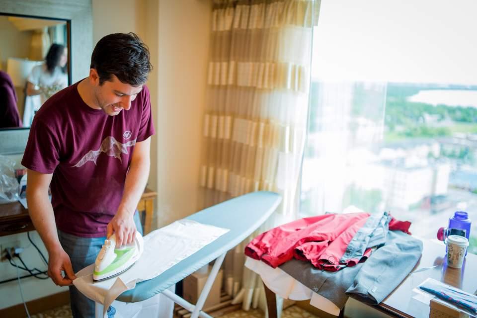 groom ironing his wedding attire