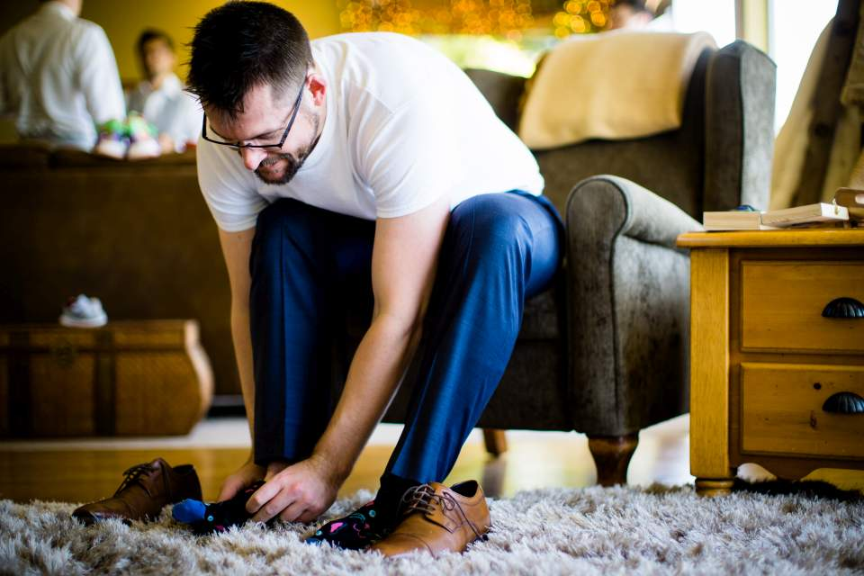 groom putting shoes on