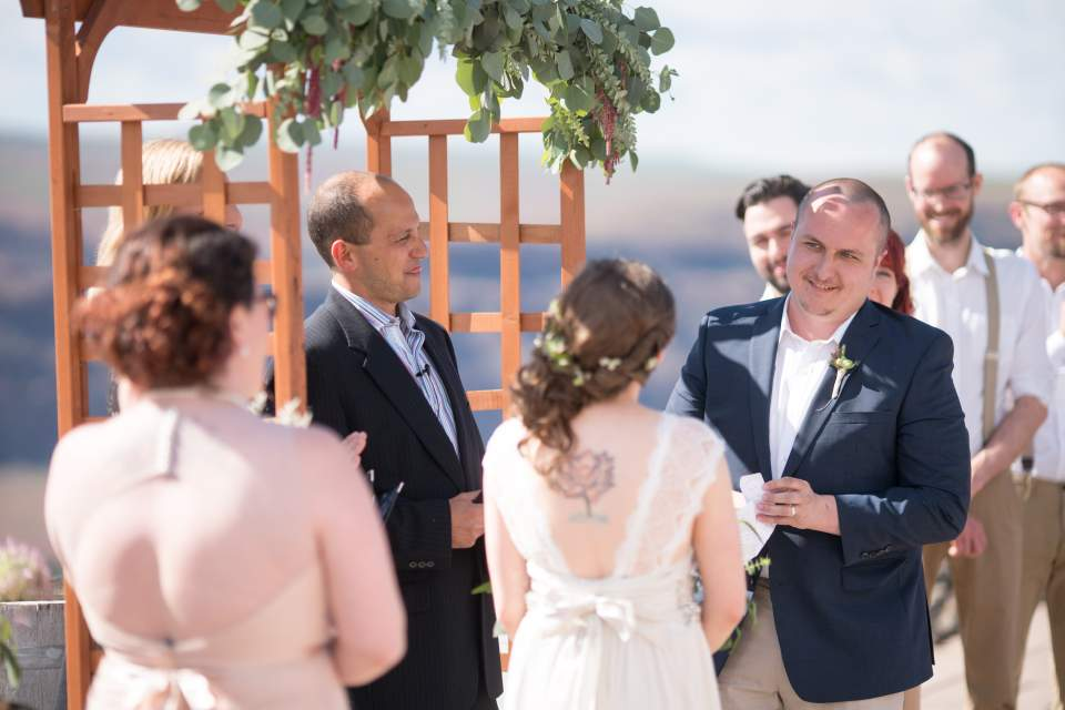 groom reading vows to his bride